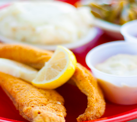 Catfish filet with lemon, mashed potatoes, green beans